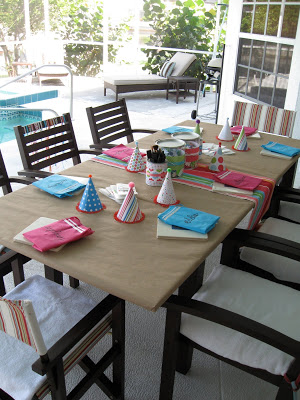 The crafty birthday party table was set up next to the pool.