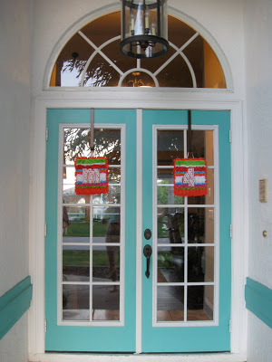We decorated the doors with colorful signs for the party.