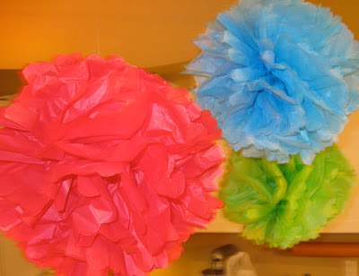 These DIY tissue paper party puffs are easy to hang and are inexpensive to make.