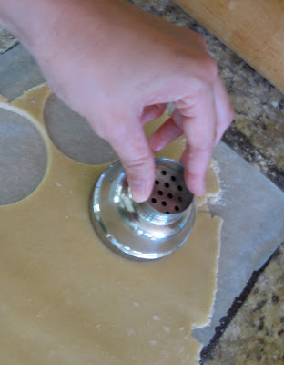 Use a cutter to create uniform cookies.