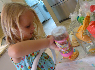 Kids love helping to decorate sugar cookies.