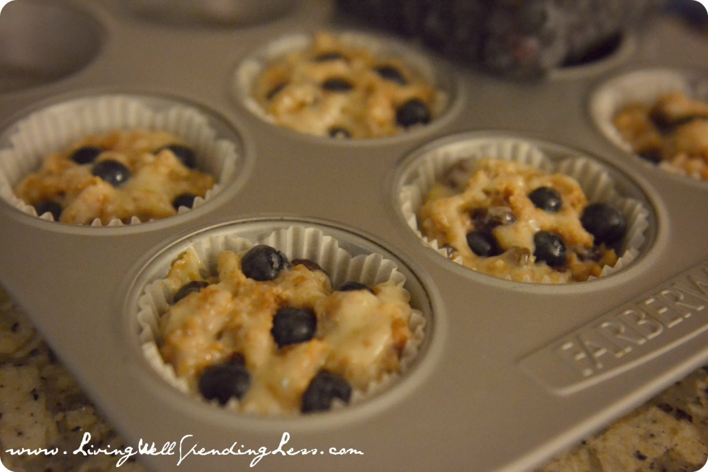 Fill lined muffin cups with the batter and add a small handful of blueberries to each muffin.