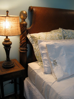 Bedside lamp and monogrammed pillow shams.
