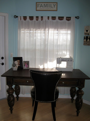 A spot by the window is perfect for a sewing table and work space.