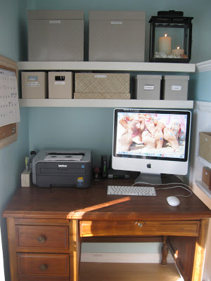 A small corner of the bedroom becomes a computer work station with boxes to organize personal items.