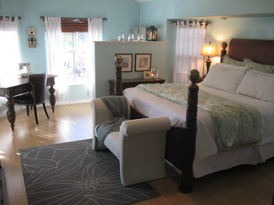 Our master bedroom after our redecorating: soft blue walls with white and green accents.