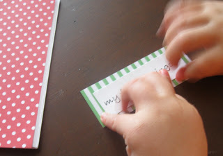 Glue the label onto the festive coloring book.