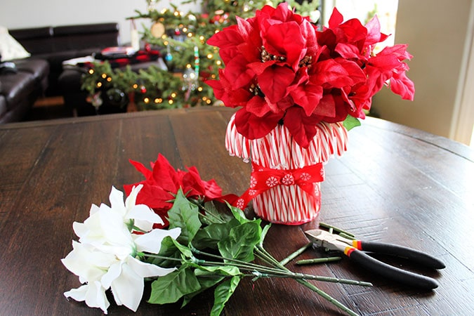 Looking for the perfect holiday centerpiece? This easy DIY candy cane vase is a budget-friendly project that will be the star of your holiday table!