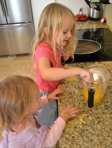 Sisters helping with cracking eggs for this best ever scrambled egg recipe.