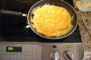 Sprinkle cheese on top of your scrambled egg mixture.