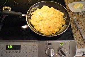 Once the eggs have set, you only need to stir them one time. This will keep them fluffy and result in perfect scrambled eggs.