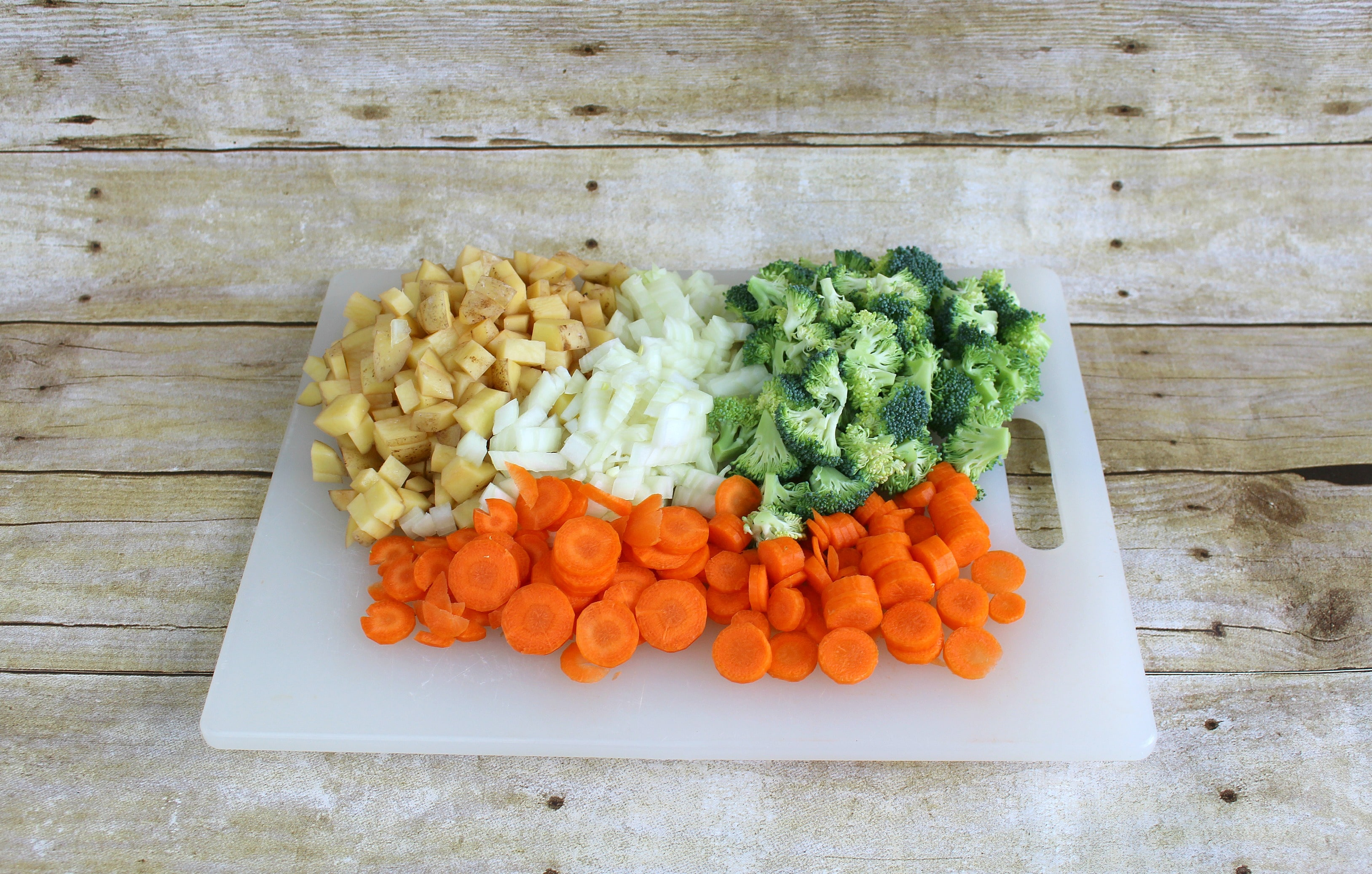 Step 1 of the Roasted Vegetable Pot Pie Pockets recipe is to chop the vegetables.