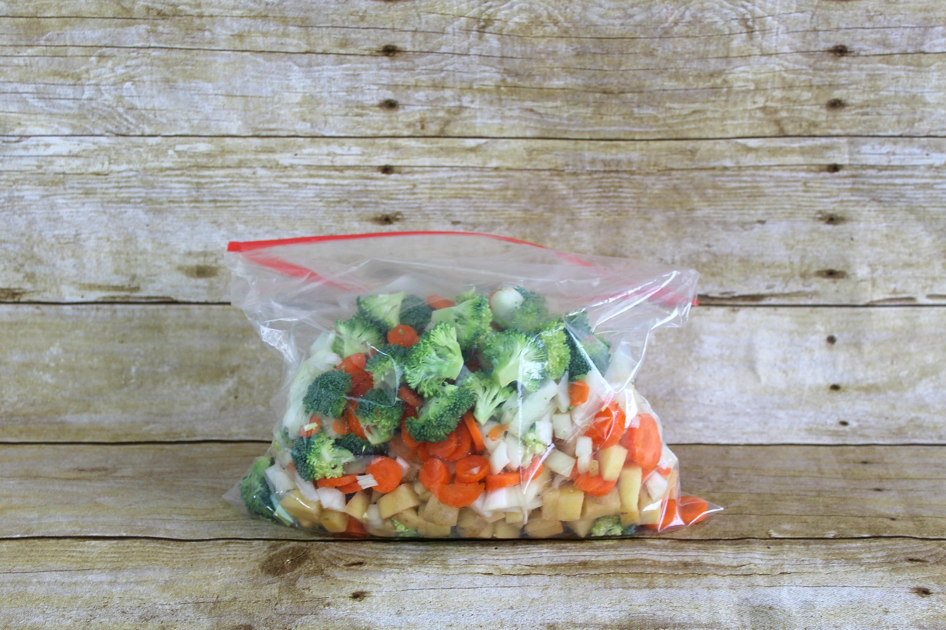 Step 2 of the Roasted Vegetable Pot Pie Pockets Recipe is to place the veggies in a gallon size bag.