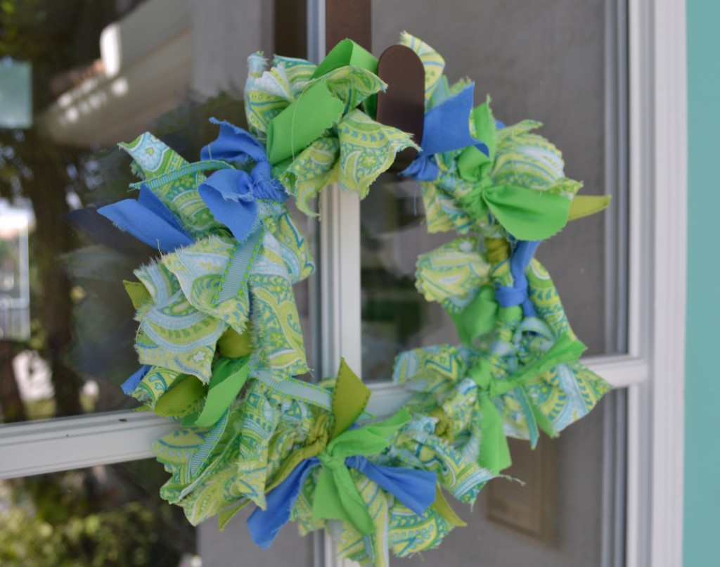 This DIY fabric wreath is a nice decor touch to the front door.