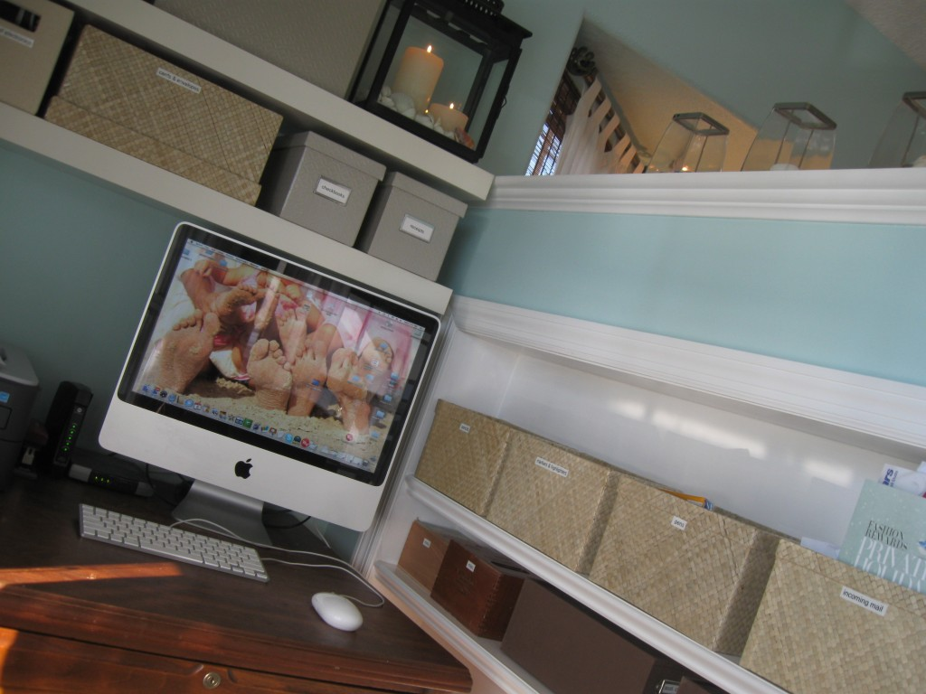 Nesting boxes throughout your home office are great ways to keep items organized.