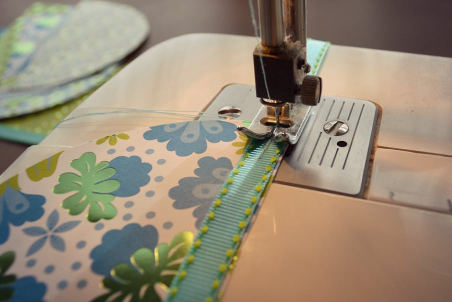 Sew ribbon onto the edges of your half circle pieces of paper stock.