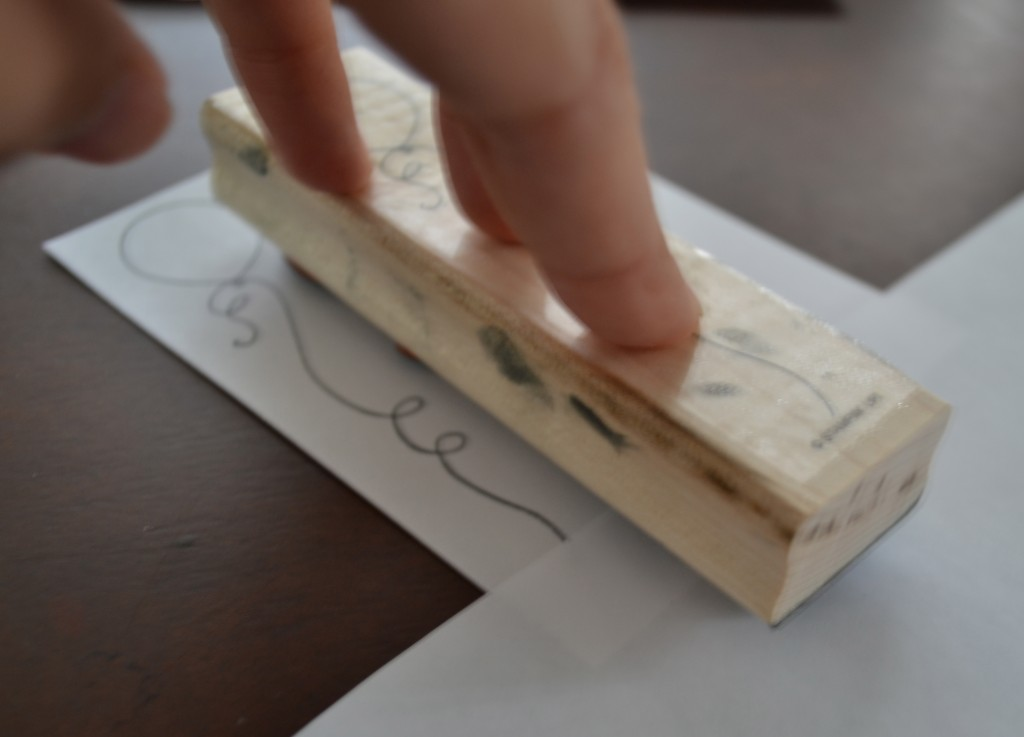 Press the stamp down on the cardstock invite.