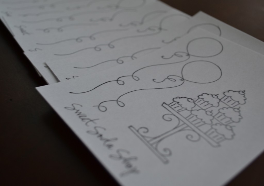Continue to hand stamp invitations until they're all done.