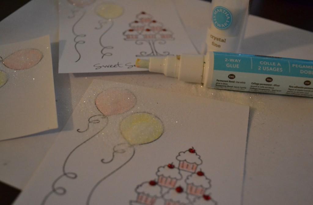 Add more glitter using glue to the invites.