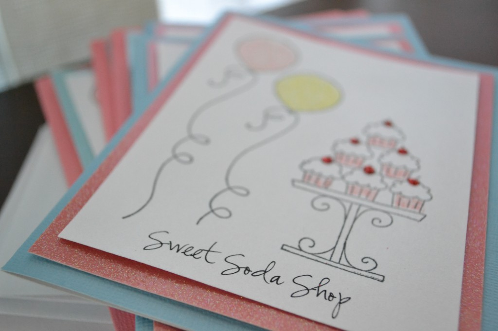 Stack DIY invitations to be mailed out.