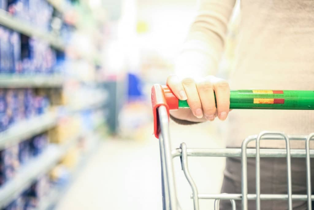 Using coupons in the grocery store are a great way to save money.