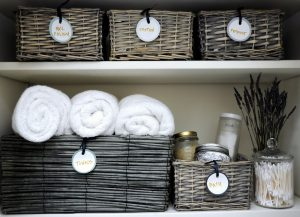 organize towels and other bathroom things in cute baskets and jars.