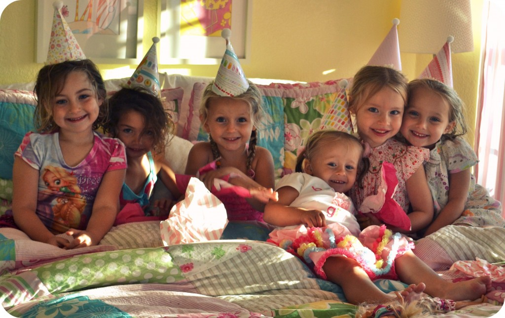 Throwing an entertaining party for kids is easy, even on a budget: just look at all these happy smiles in their party hats!