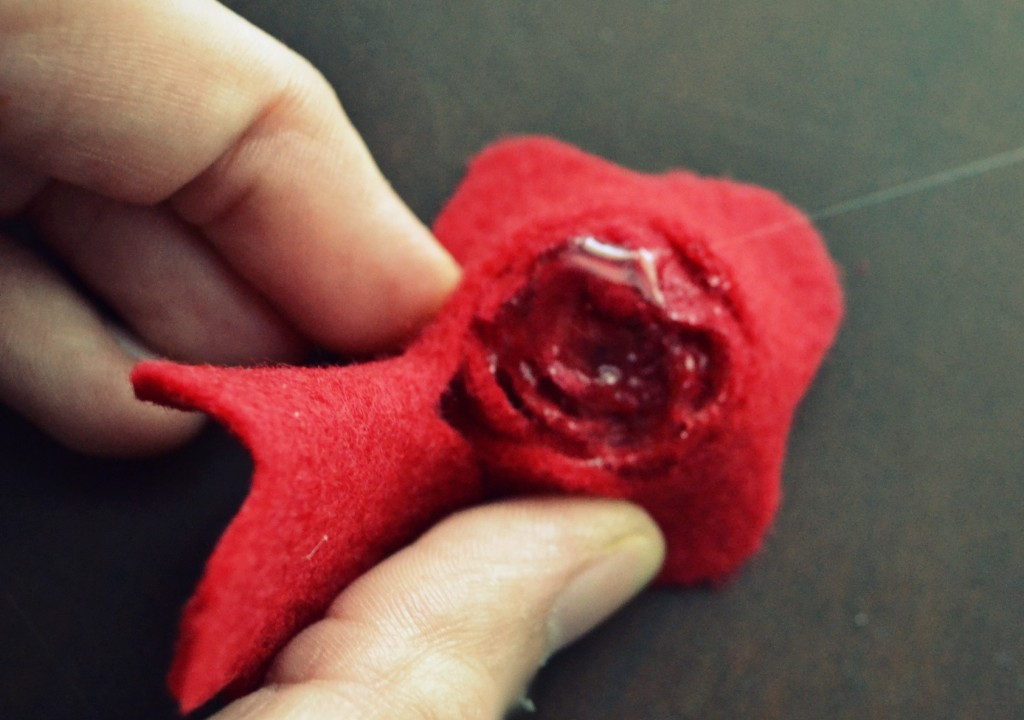 When you get to the end, hold in place with hot glue and use the center of felt circle as the base of the flower.