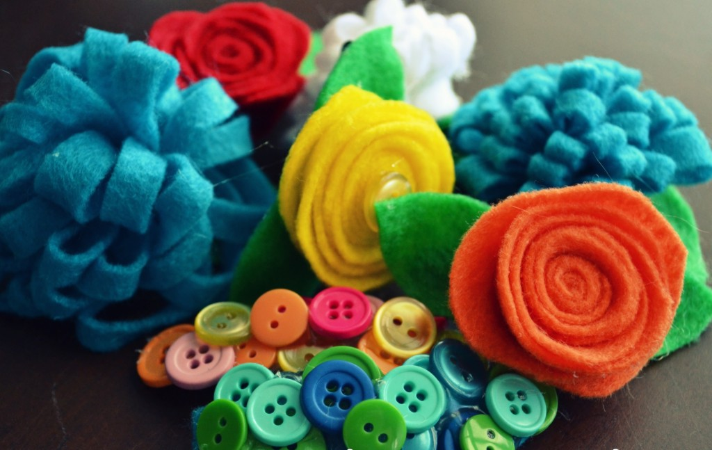 Arrange felt flowers and buttons in any way you'd like onto clips.