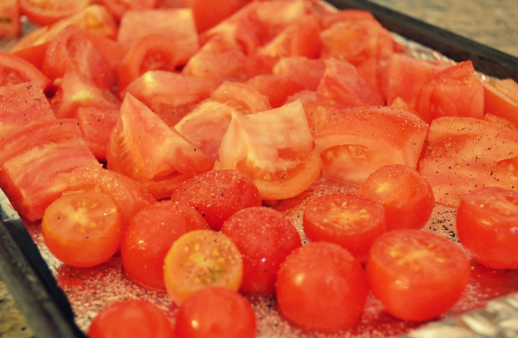 To cook the winter diet soup, begin by arranging baby tomatoes on a foil lined pan topped with olive oil, salt, and pepper.