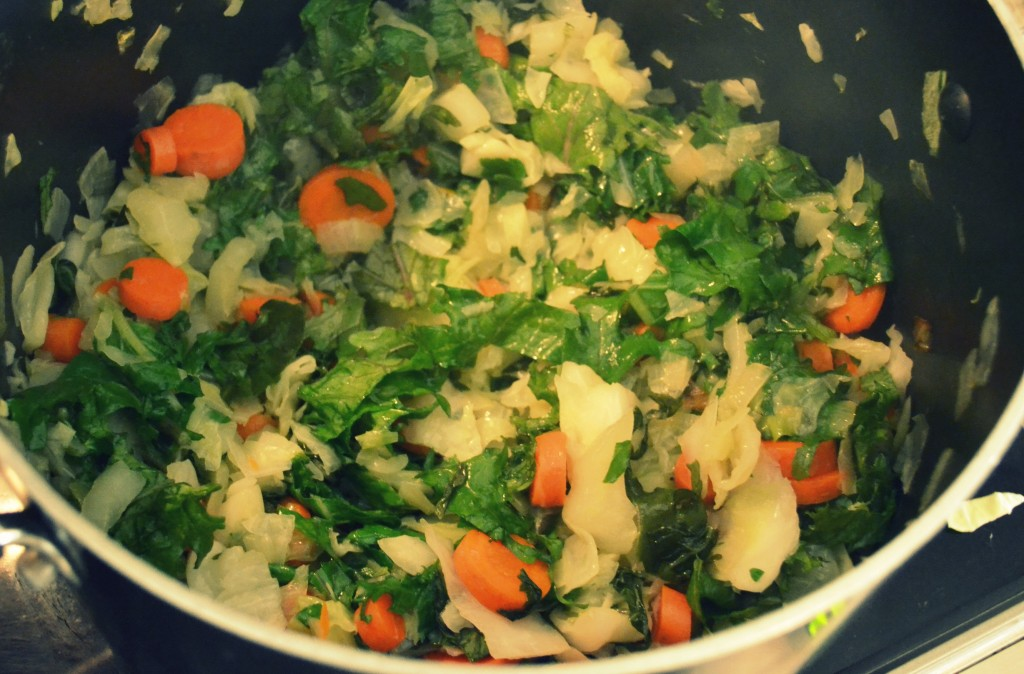 Add additional vegetables to the pot like carrots and herbs then saute.