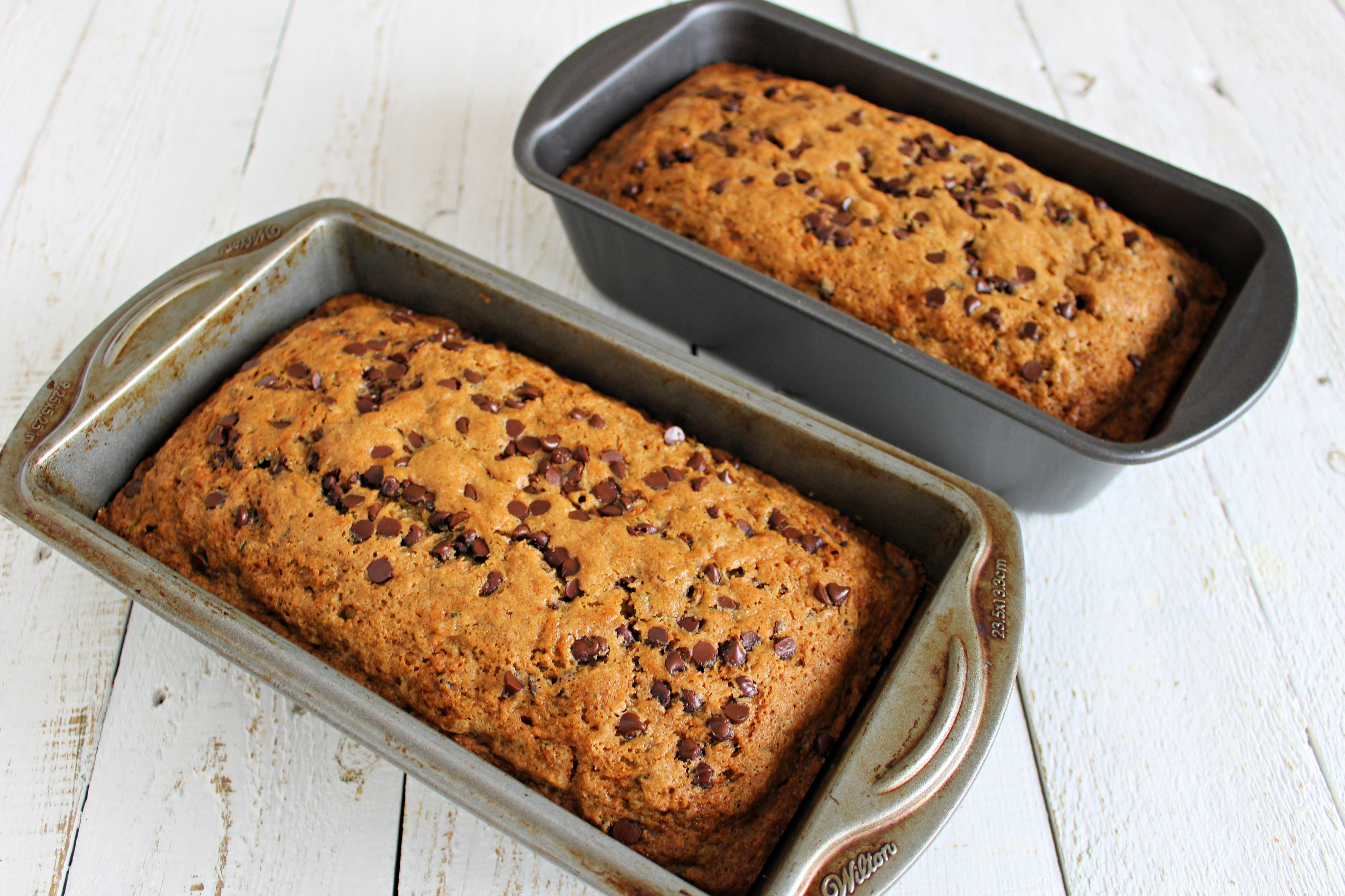 Got zucchinis? This super moist & ridiculously easy zucchini bread recipe whips up fast and makes enough to share! It also freezes beautifully!