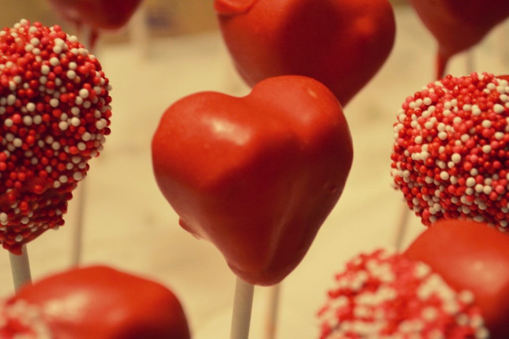 Allow candy covered heart shaped cake pops to dry.