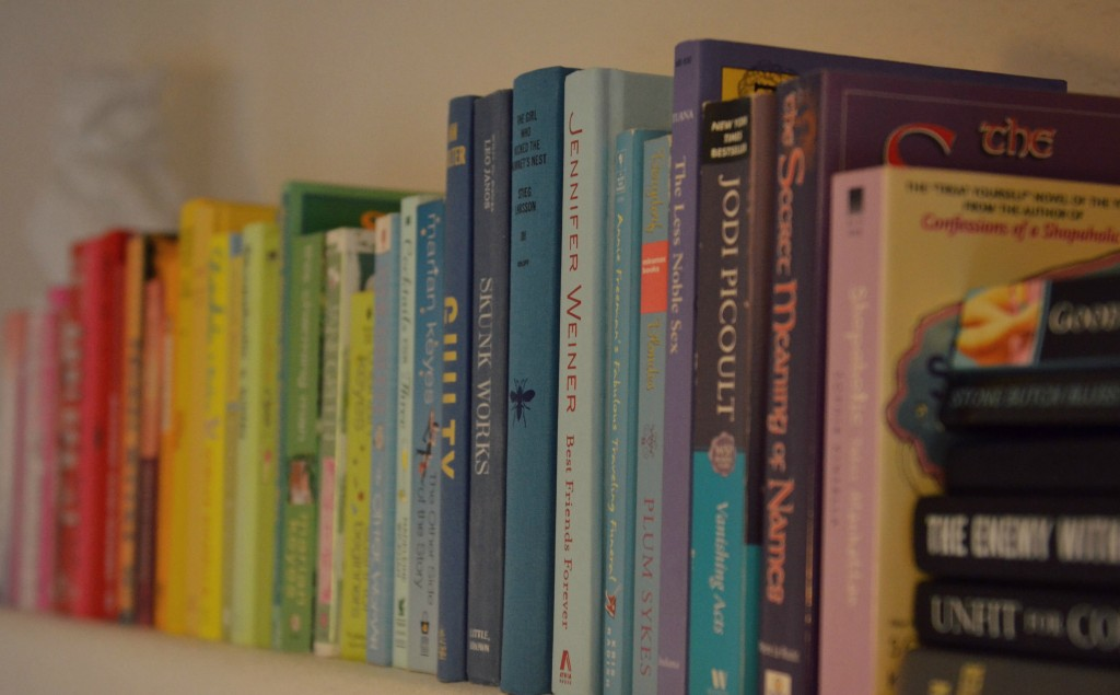 The first step to our rainbow theme was to arrange all the books in the order of a rainbow