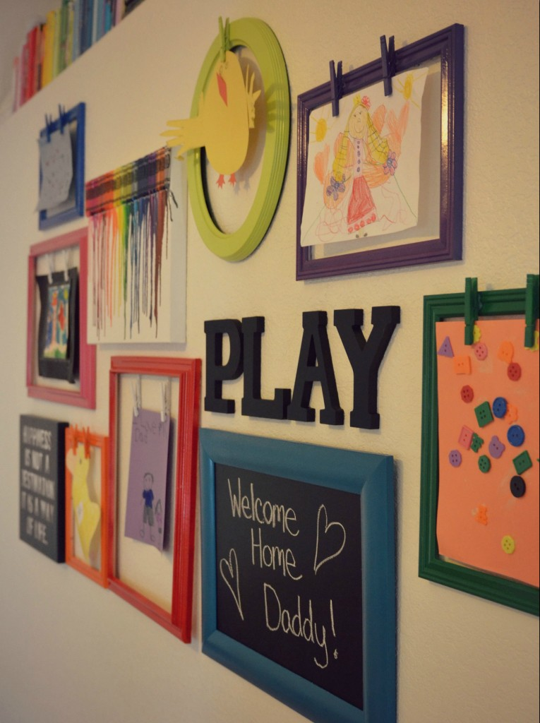 The kids artwork graces the wall of the rainbow play room