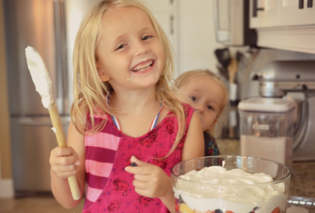 Kids will love to help add the whipped cream to the Olympic inspired dessert for the party.