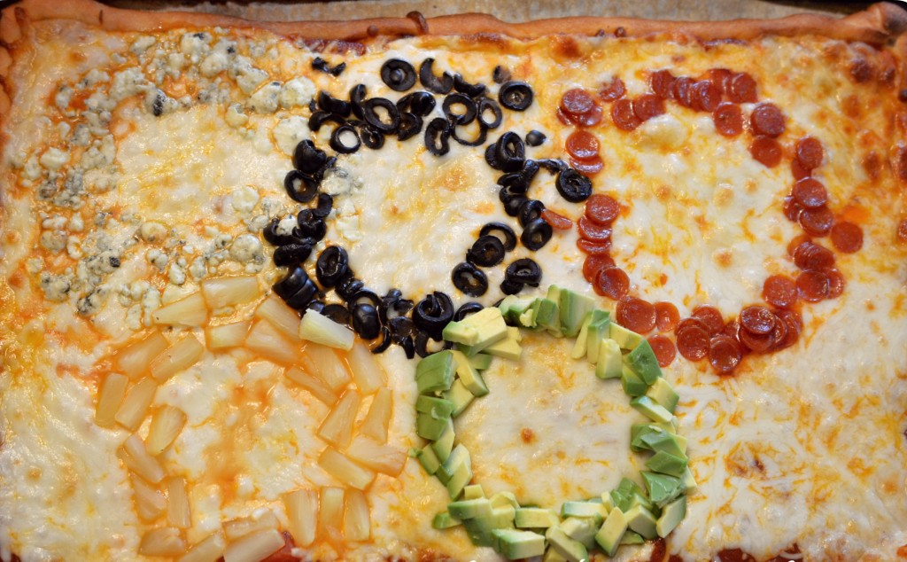 This homemade Olympic ring pizza made from blue cheese, olives, pepperoni, pineapple and avocado is delicious.