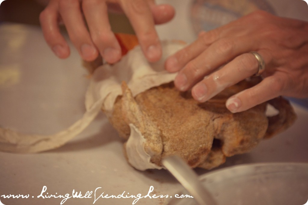 Wrap the whole chicken with fabric.