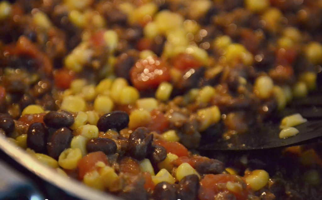 Combine butter brown vegetarian crumbles, water, taco seasoning, tomatoes, black beans and corn in large saucepan