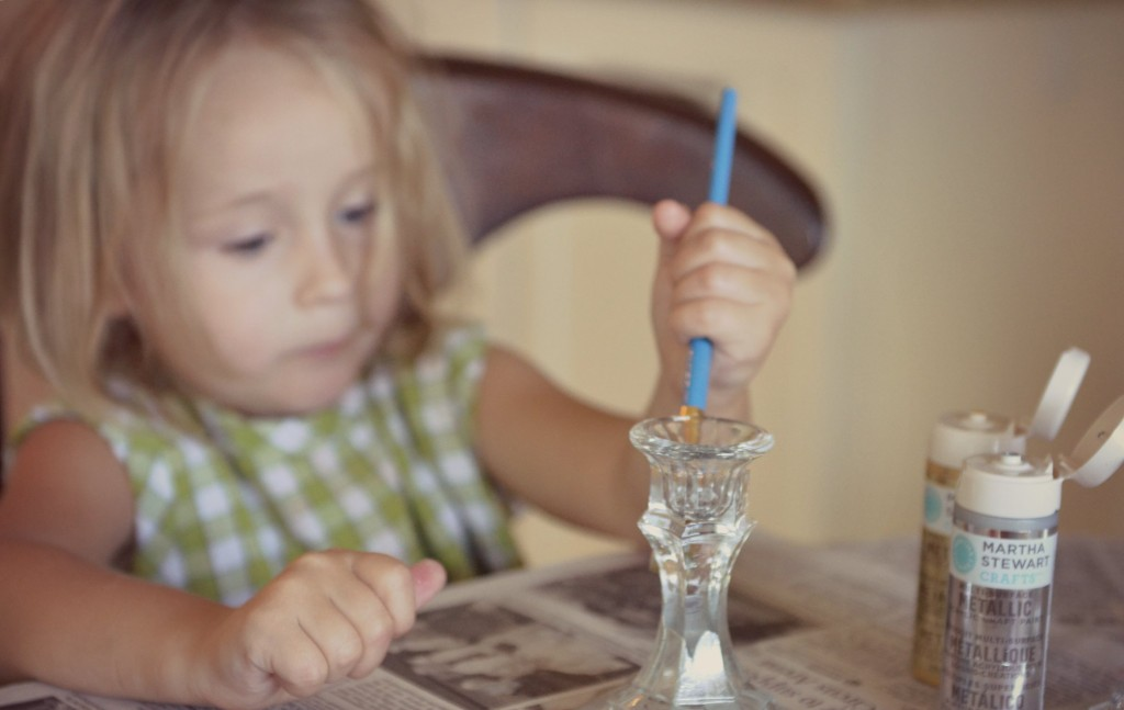 Paint your dollar store candle sticks with the Martha Stewart metallic paint.