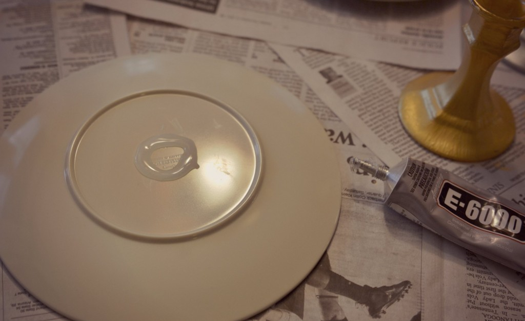 Use E-6000 adhesive on the back of the plate to attach candlestick.