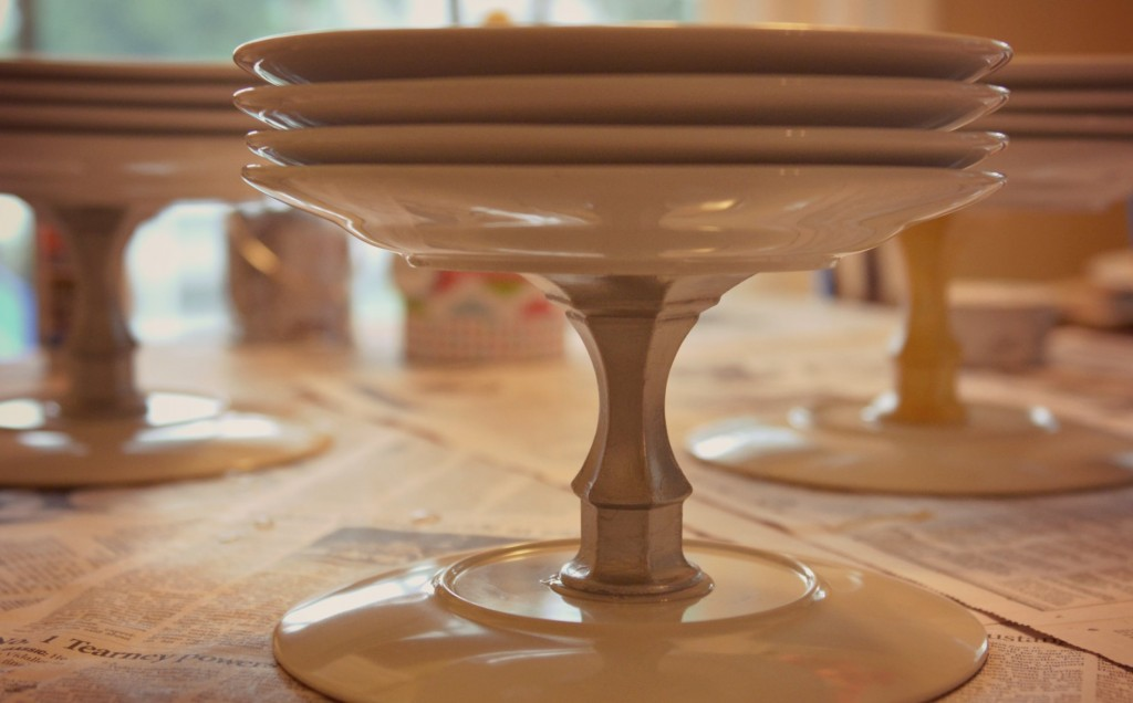 Weigh down the candlesticks with a stack of plates and let them dry.