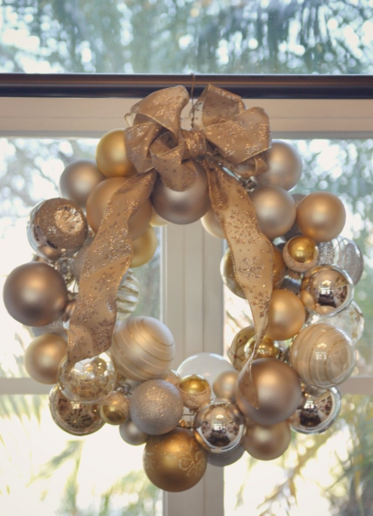 A bow on top adds a nice festive touch to the ornament wreath.