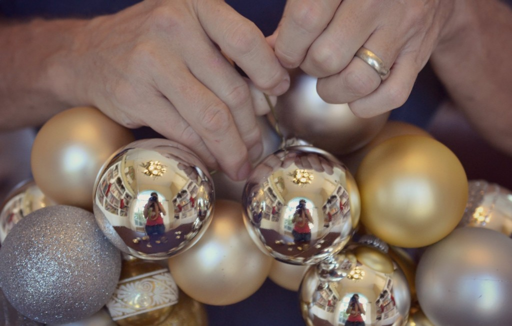 Once the hanger is full of ornaments carefully twist it back together again.