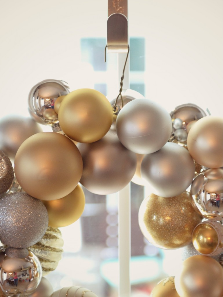 Hang your finished DIY ornament wreath for everyone to see.