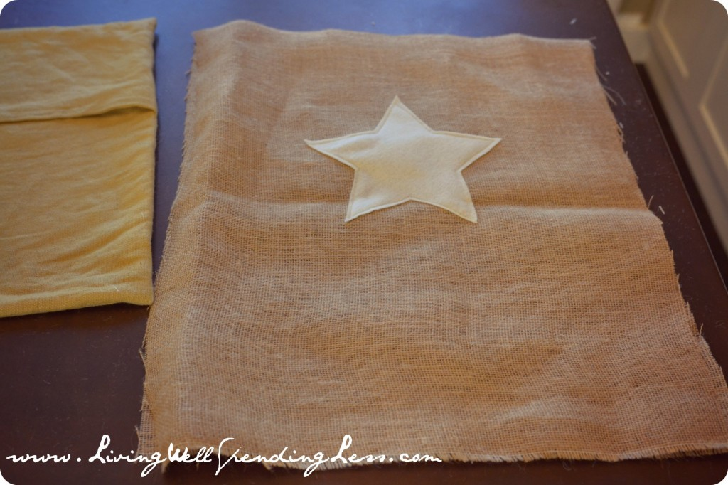 After sewing is complete, star should be completely secured to burlap without pins.
