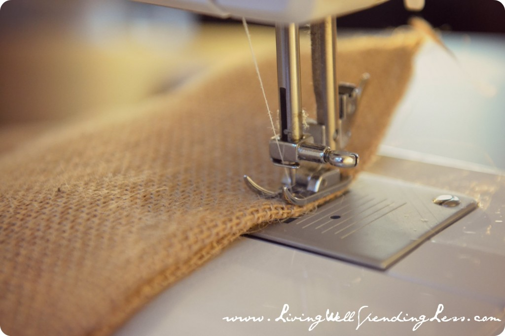 Starting at one bottom corner, sew two sides of burlap together for a few inches.