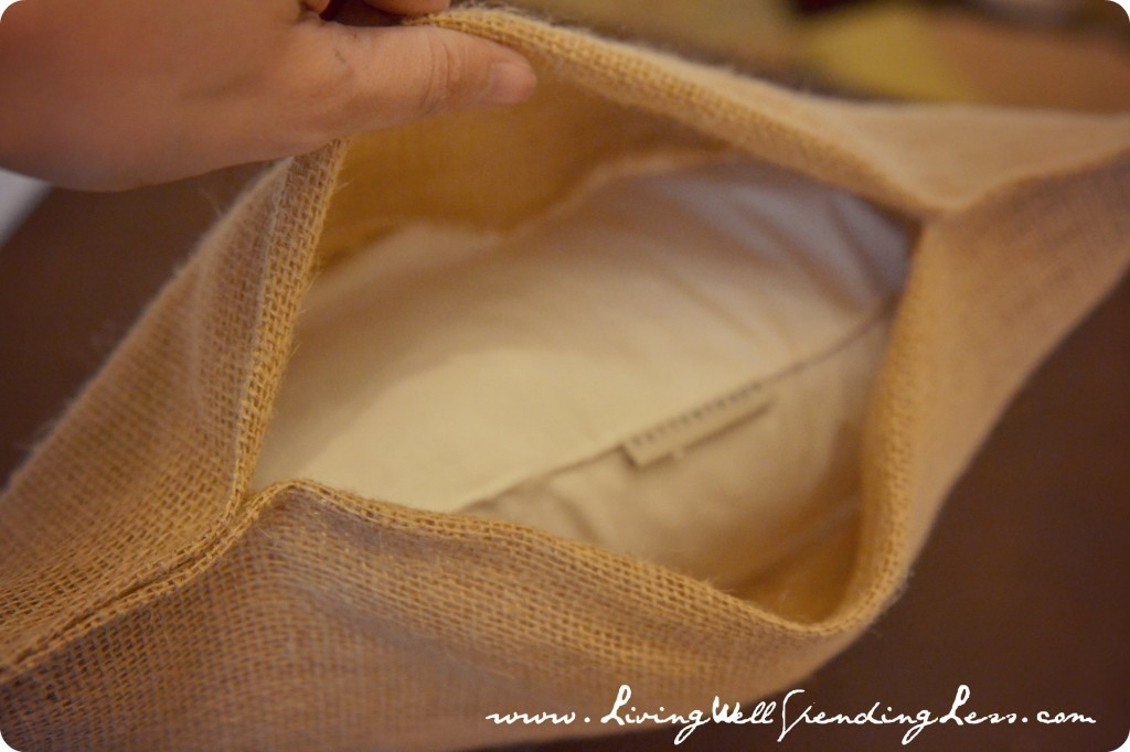 Once your pillow is in, pull the flap of longer fabric over the pillow and flatten.