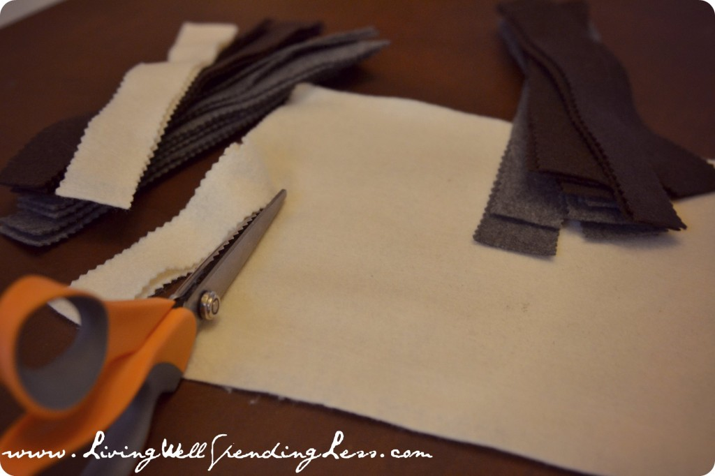 Cut strips of felt with pinking shears.