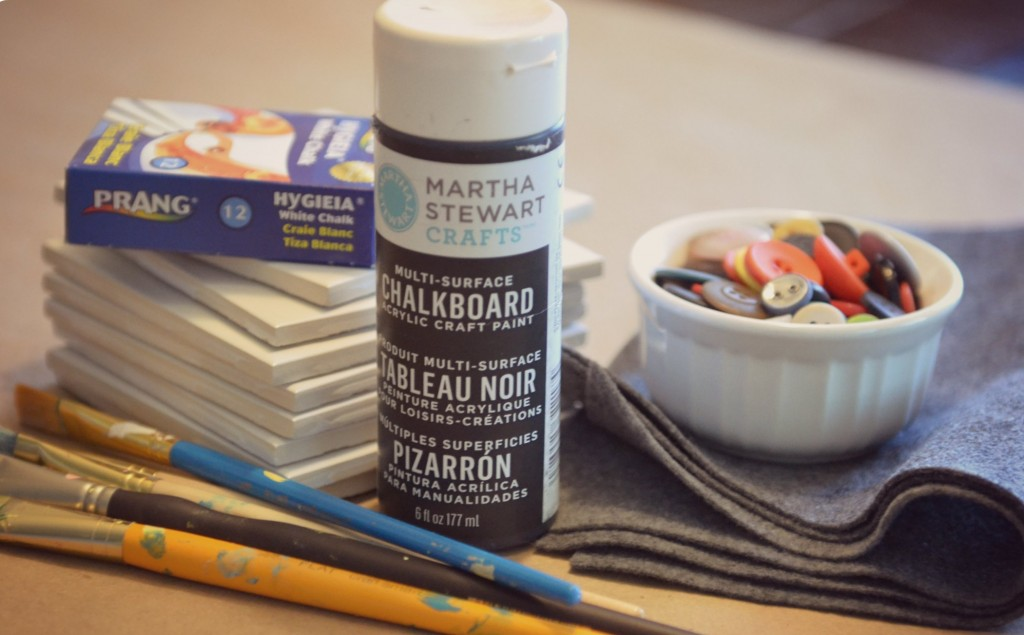 DIY Chalkboard Coaster Set | Supplies needed: chalkboard spray paint, paint brushes, some cheap plain white tiles, buttons (use any color you'd like!) and some felt squares.